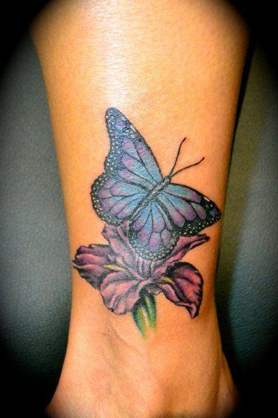 Photo tattoo feminin papillon sur fleur cheville mollet tatouage femme - Catalogue tatouage femme ...