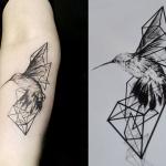 Photo tattoo signe oiseau origami
