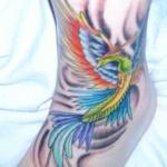 exemple tatouage phoenix femme couleur sur cheville