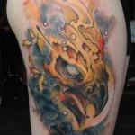 exemple tatouage tete de phoenix femme sur le bras