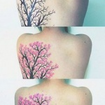 photo tattoo feminin arbre chinois dos cote gauche coeur