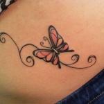 modele tatouage papillon et arabesque sur ventre feminin