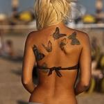 tatouage symboles 6 papillons dans le dos