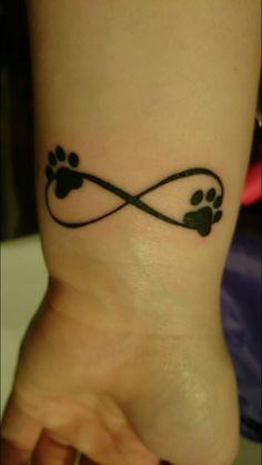 tatouage symboles infinis avec 2 empreintes de chat tatouage femme. Black Bedroom Furniture Sets. Home Design Ideas